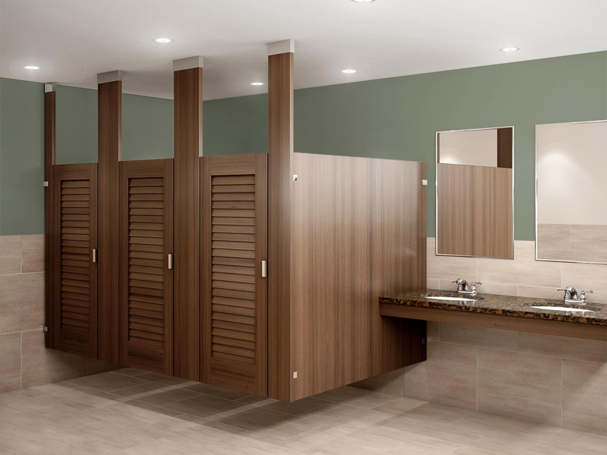 Standard size wood grain plastic laminate bathroom partitions featuring three louver doors in ceiling hung configuration.