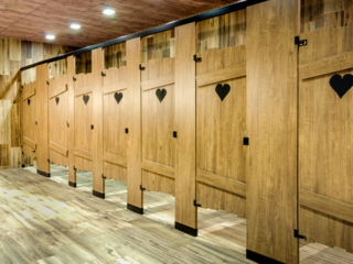 Custom shape bathroom partitions with heart shape engraving on brown, outhouse look laminate doors with powder coat hardware.