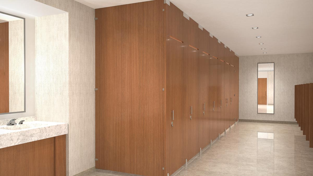 Expansive office employee all gender bathroom with compact laminate partitions in oversize configuration showing transoms for added privacy.
