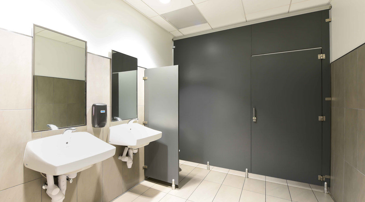 Charcoal grey, plastic laminate european style bathroom partition give a feeling of privacy while providing a clean, modern appearance.