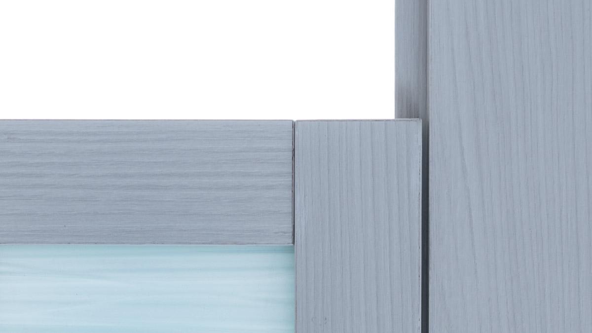 Close up view of zero sightline of grey bathroom door with acrylic insert.