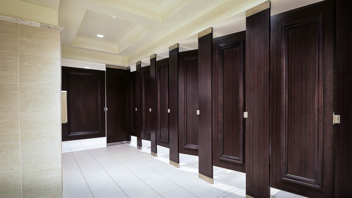 Seven, Dark Wood Grain Plastic Laminate Bathroom Partitions And Doors  Accentuating Picture Frame Molding.